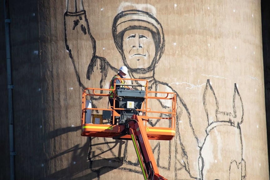 Peter Mortimore painting a silo