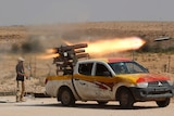 Interim government fighters are bogged down in sieges of Gaddafi loyalists' remaining bastions.