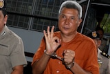 Tom Dundee, a Thai singer accused of insulting Thailand's king, gestures as he arrives at a Bangkok court on June 1 2016.