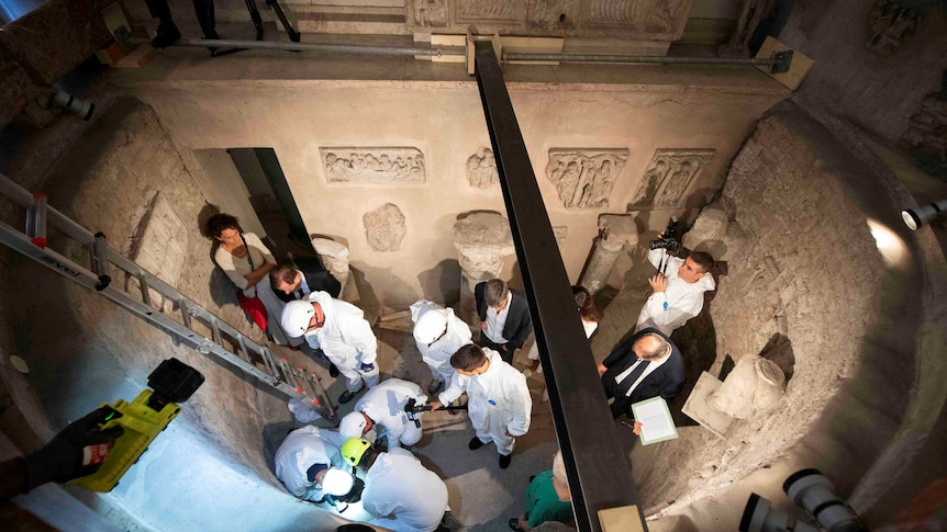 Experts open the ossuary at the Teutonic Cemetery in the Holy See, Vatican City.