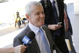 Senator Malcolm Roberts arrives at the High Court to plead his case in the hearing over his dual citizenship.