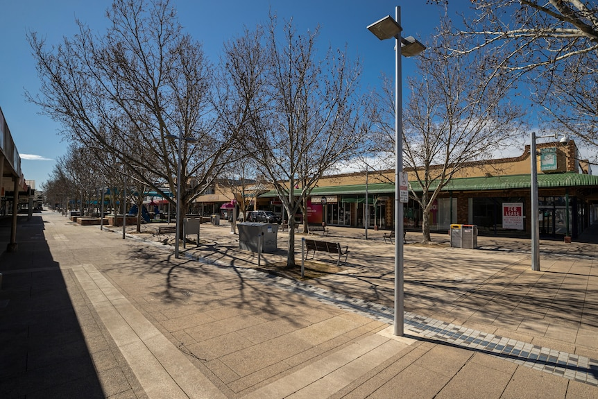 The near-empty Maude Street Mall, on a clear bright day with blue skies.