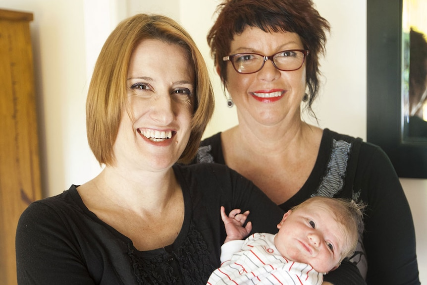 Christine Percy with her son James, and her midwife Karen Hayes in Brisbane in 2013