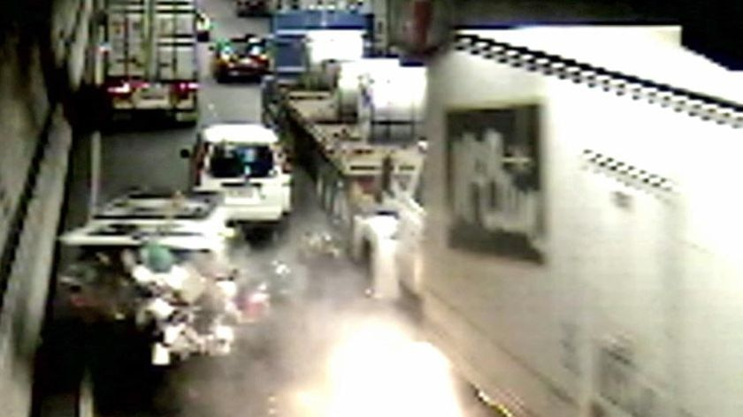 The first fire breaks out after the accident in the Burnley tunnel.