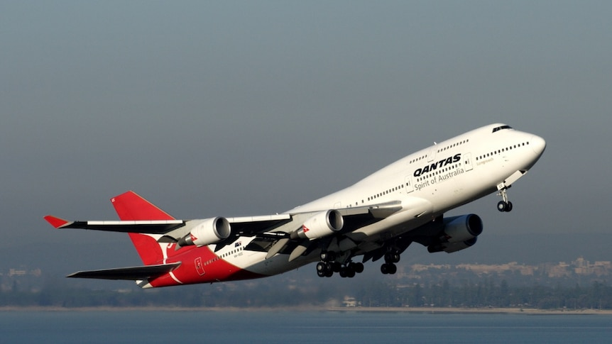 A Qantas plane takes off over Sydney.