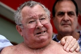 Flood victim Frank Beaumont shows emotion after listening to a live stream of the court decision.