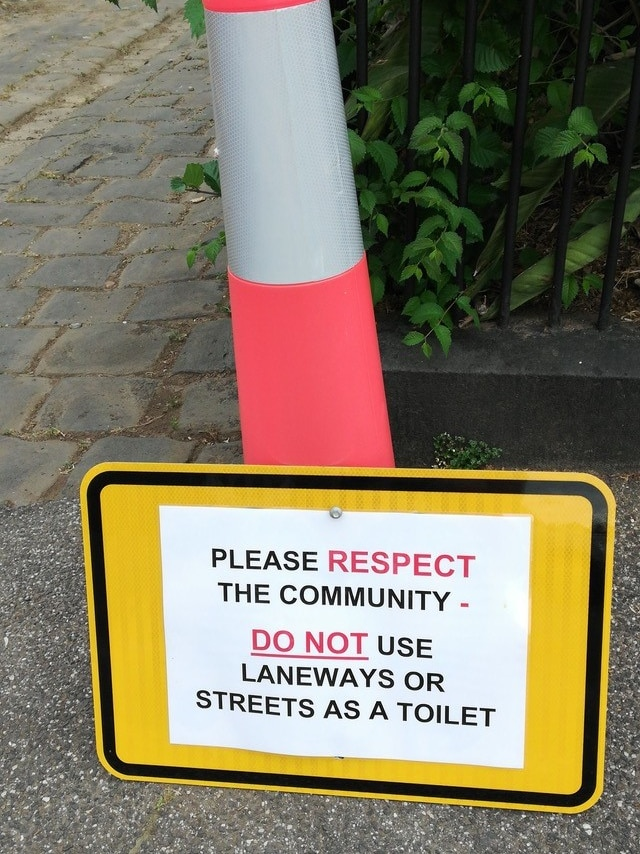"A sign put up in a laneway off Edinburgh Gardens, put up by locals, asking people to not ""use laneways or streets as a toilet""."