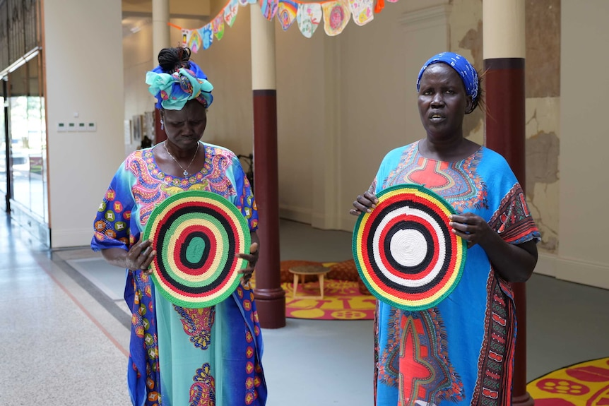 Abuk Chol Malual and Abuol Mayen Mabior are part of the White Nile women's group in Bendigo.
