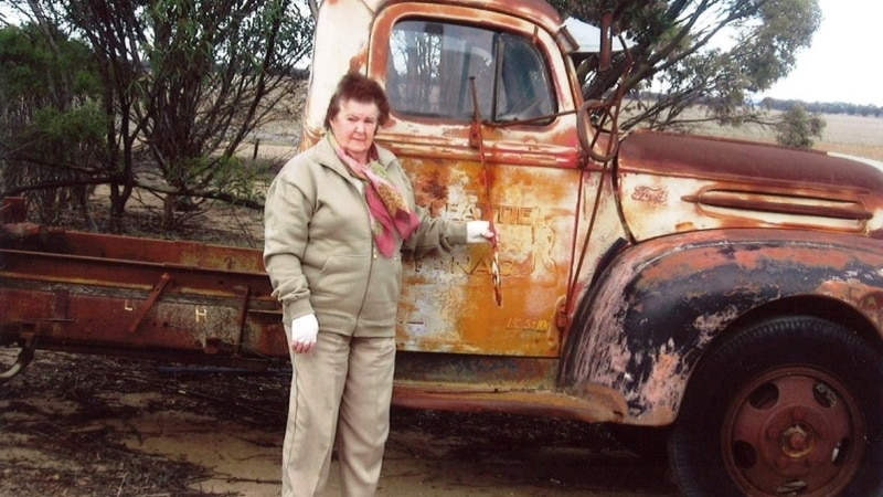 Woman with old truck.