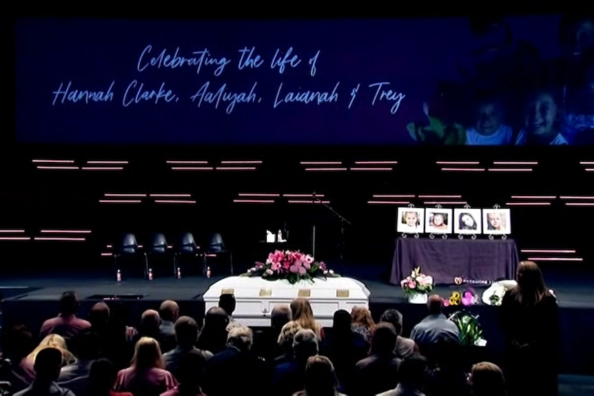 Coffin sits in front of the congregation.