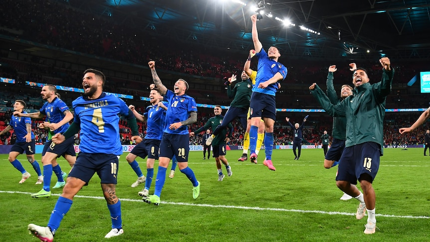 Italy players run and leap for joy in celebration