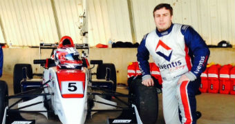 Adam Cranston next to a racecar