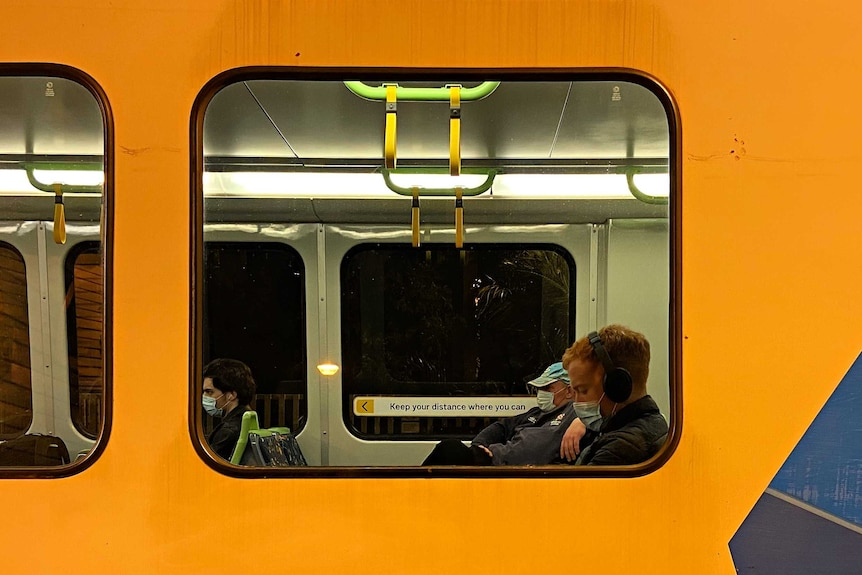 Passengers wearing masks on a Melbourne Metro train.