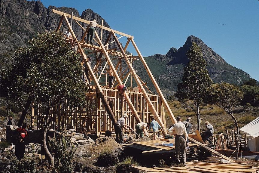 Wooden frame dwelling being built in Tasmanian wilderness.