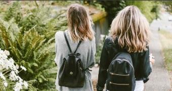 Teenage girls walking along the street.