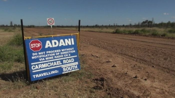 Sign on dirt road to Adani Carmichael mine in central Queensland