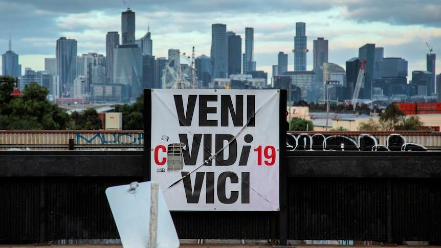 """An altered sign outside Melbourne reading """"Veni Covidi-19 Vici"""""""