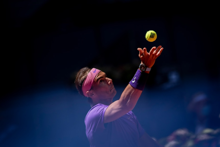Rafael Nadal early in his ball toss while serving.