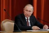 Putin looks displeased