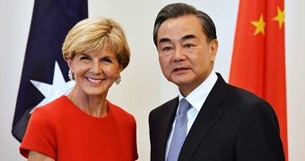 Julie Bishop and China's Foreign Minister Wang Yi shake hands.