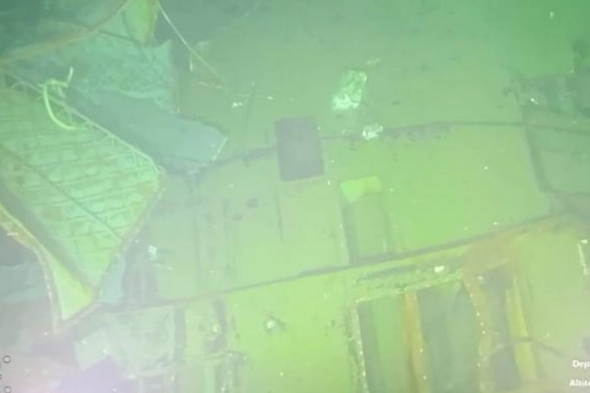 A grainy image of submarine wreckage underwater