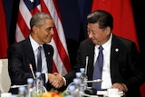 US president Barack Obama shakes hands with Chinese president Xi Jinping.