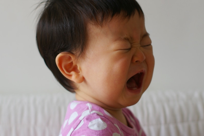 A small child crying.