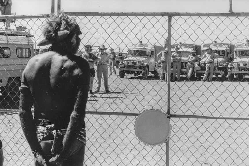 Aboriginal activist Don McLeod eyes off authorities during the Noonkanbah dispute after leading a ceremony to reclaim the land.