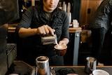 Trendy looking barista making coffee