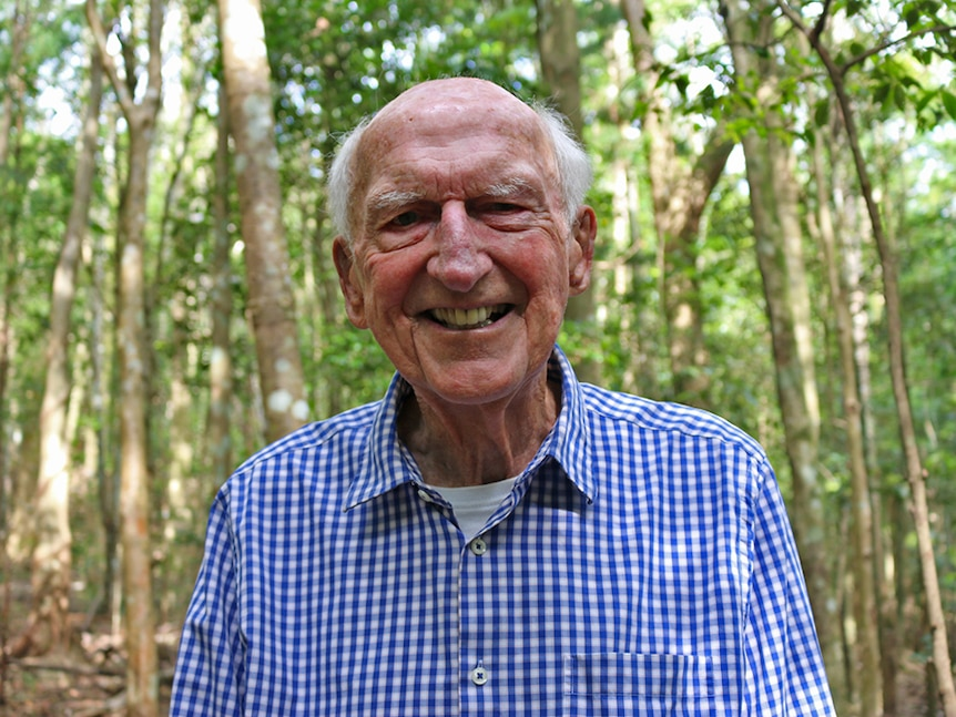 Dr Tony Parkes stands in the Big Scrub rainforest restored on his property.