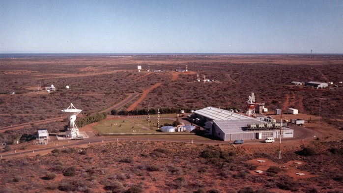 An aerial photo of the station showing the large dish and buildings at the station.
