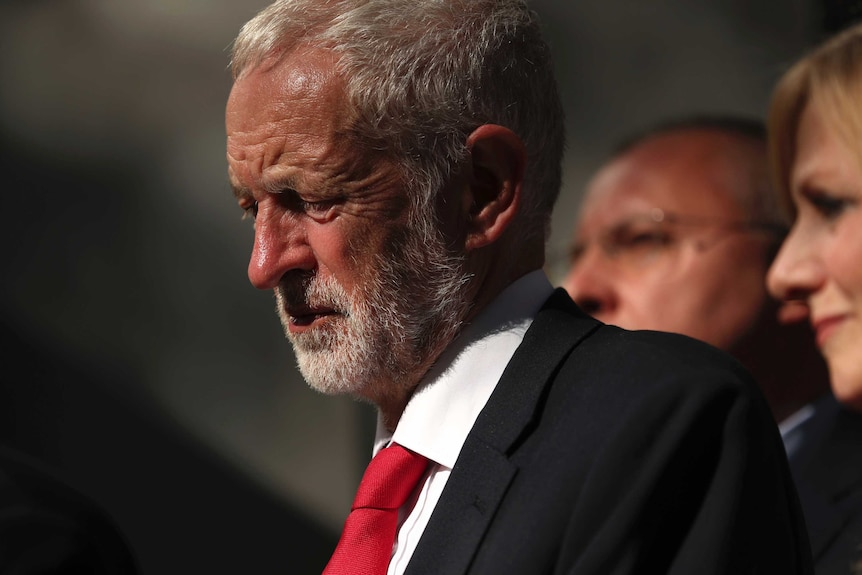 Labour leader Jeremy Corbyn wearing a suit and red tie