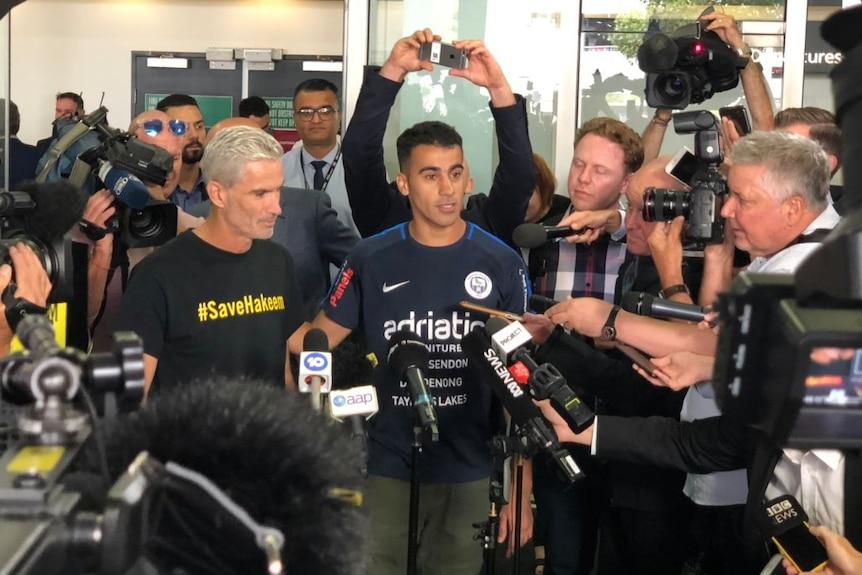 Hakeem al-Araibi speaking to a media scrum at Melbourne Airport.