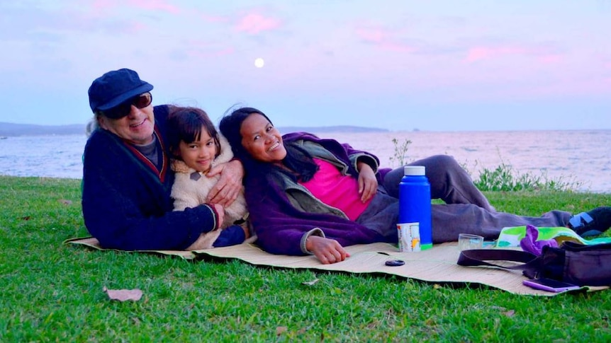 John Smith with his family on a picnic.
