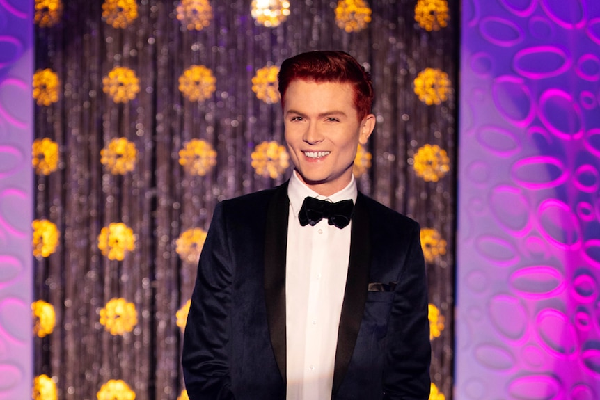 Comedian Rhys Nicholson standing on the runway of RuPaul's Drag Race Down Under