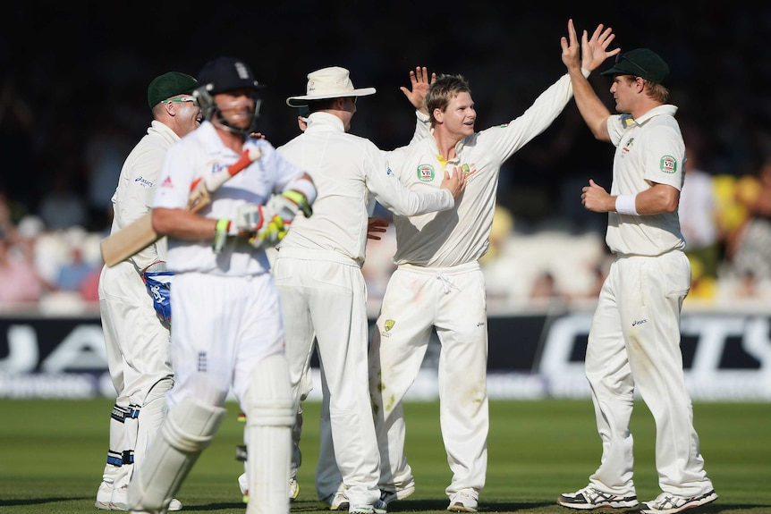 Man of the moment ... Steve Smith celebrates the wicket of Ian Bell with his team-mates