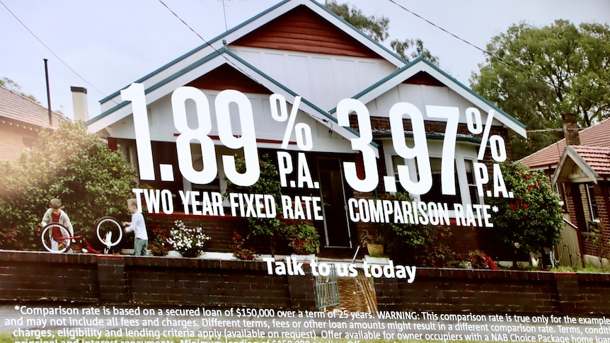 A poster at an NAB branch advertises a 1.89pc two-year fixed rate with a house in the image.