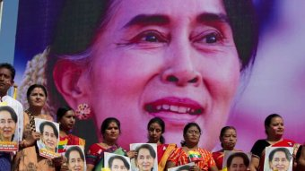 Banner of Aung San Suu Kyi with her supporters.