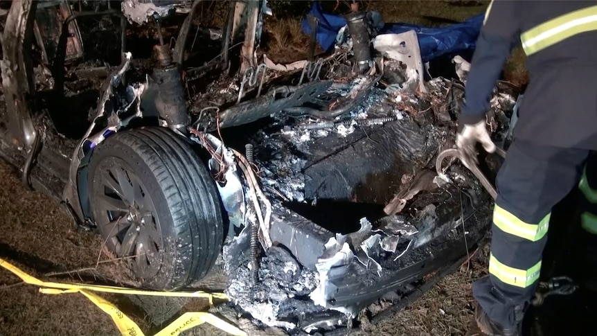 The remains of a Tesla vehicle are seen after it crashed in The Woodlands, Texas, April 17, 2021.
