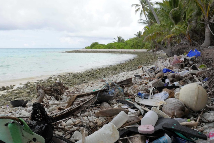 Plastic and rubbish debris on a beach on Direction Island in the Cocos Islands