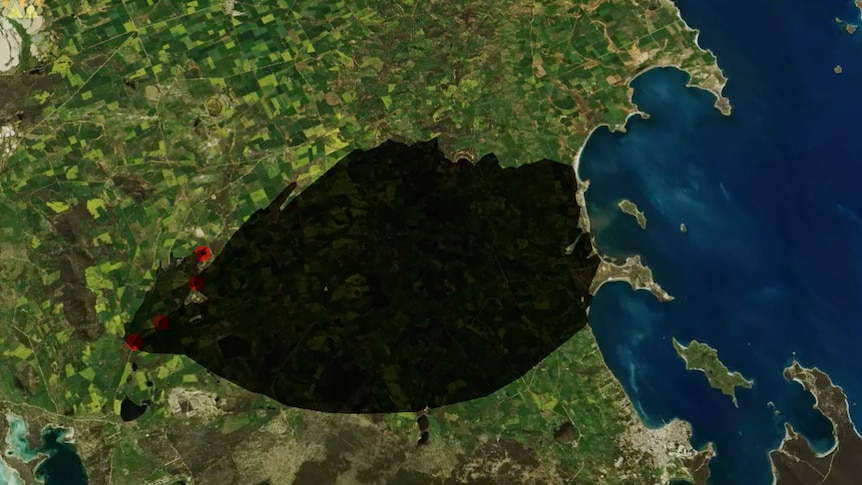 A computer graphic image showing a large black area on a map representing the forecast spread of a bushfire.