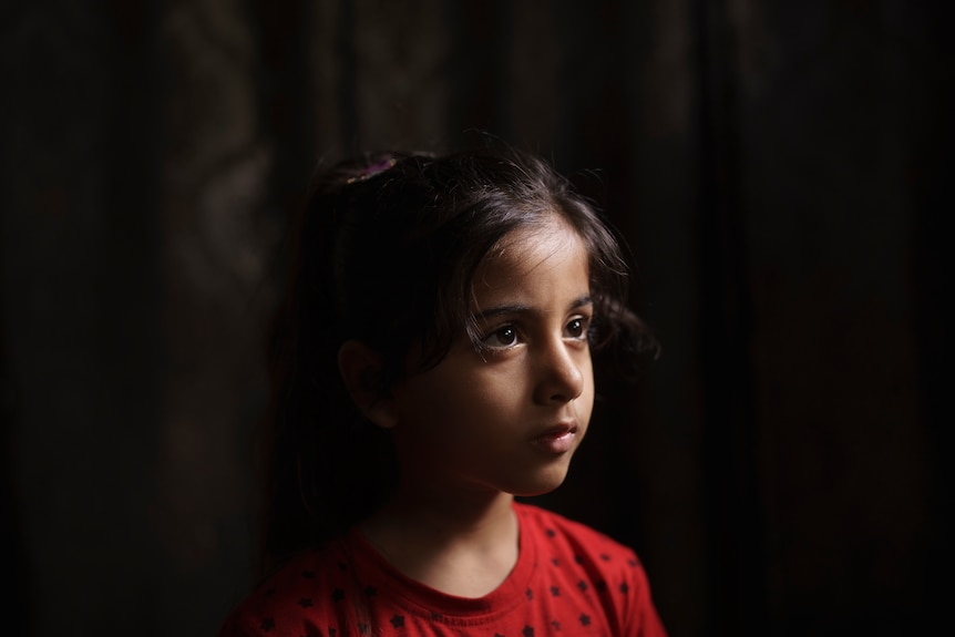Elien al-Madhoun, 6, poses for a portrait at her grandfather's house, where she is living after her house was destroyed