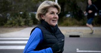 Julie Bishop smiles as she completes her morning jog