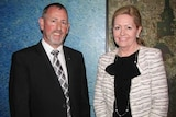 Gary Stevenson stands wearing a suit and tie alongside City of Perth Mayor Lisa Scaffidi.