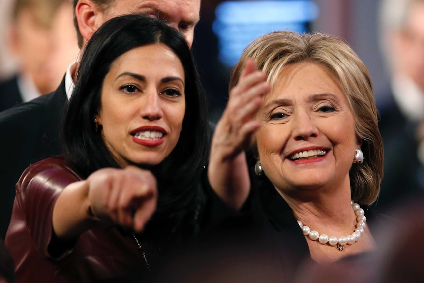 Huma Abedin stands next to Hillary Clinton at the end of the second official US Democratic presidential candidates debate.