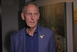 Bob Brown wears a blur shirt and blue suit jacket.