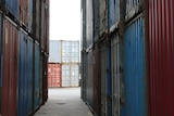 Shipping containers stacked on top of each other.