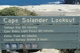 A close up shot of a sign for Cape Solander Lookout