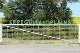 The property name Erregulla Plains sits above a farm gate with a tree and paddock in the background.