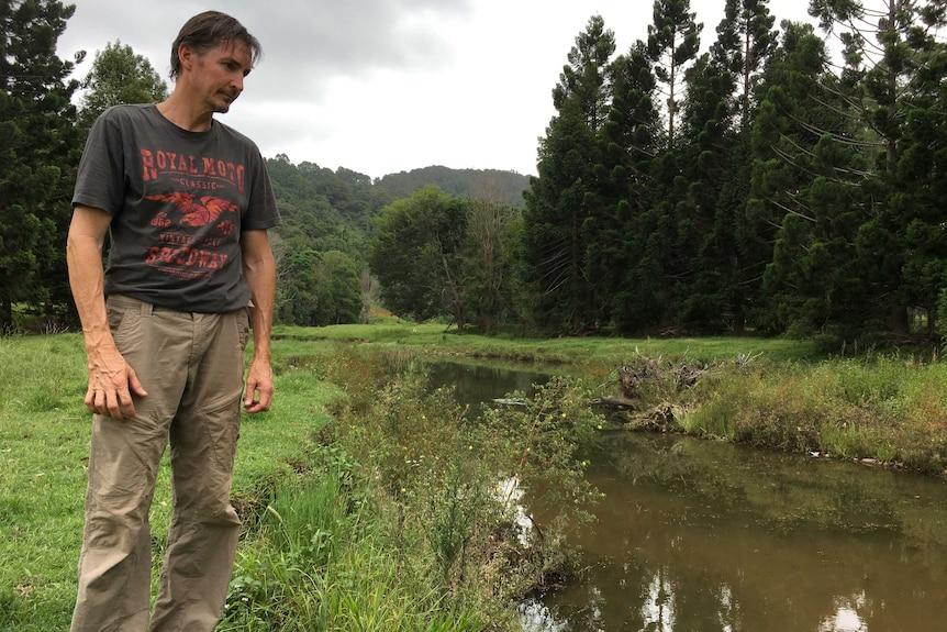 Patrick O'Brien looking at the Bilambil Creek